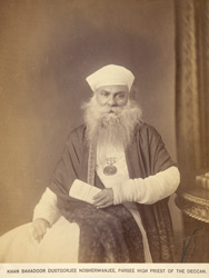 Studio portrait of Khan Bahadur Dustorjee Nosherwanjee, Parsee High Priest of the Deccan, at Bombay.